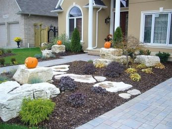 Front Entrance with stone boulders and armour stone by stone world in london ontario canada